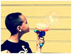 J playing with bubbles